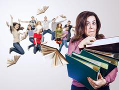 Mad teacher with folders and her jumping students - stock photo