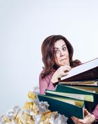 Mad woman with folders Stock Photos