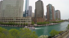 Boat on Chicago River with skyscrapers background, Illinois Stock Footage