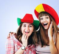 Two happy screaming girls - football fans Stock Photos