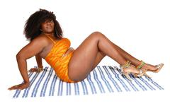 African woman sitting in bikini. Stock Photos