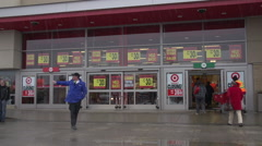 Bankruptcy -Target store closing, grey winter day, medium wide shot with traffic Stock Footage