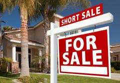 Short Sale Home For Sale Real Estate Sign and House - Right Side. Stock Photos