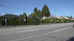 Stock Video Footage of Vancouver street Real estate signs, 2-shot