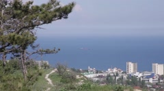 Cargo ship in the Gulf on the background of the city in the afternoon Stock Footage