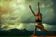 Sun Salutation yoga pose sequence Stock Photos