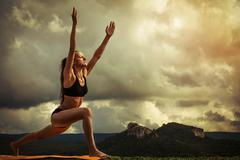 Surya Namaskara - Sun Salutation - stock photo