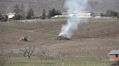 Orchard burn pile, early spring, cleaning up the land #2 Stock Footage