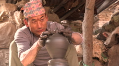 Nepalese potter at work in Bhaktapur Stock Footage