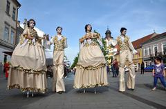 Artists on stilts performing in medieval costumes Stock Photos
