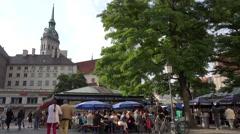 ULTRA HD 4K Tourist people enjoy meal terrace restaurant outdoor Munich food day Stock Footage
