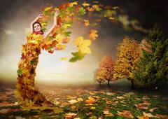 Lady Autumn with leaves wings - stock photo