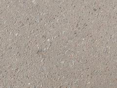 Gray asphalt with a granite crumb Stock Photos