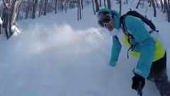 SELFIE: Snowboarder riding powder between the trees Stock Footage