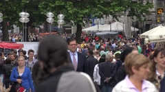 ULTRA HD 4K Crowded sidewalk commuter travel Munich commercial street people day - stock footage