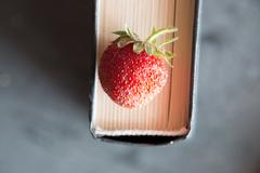 Strawberries and cook book - stock photo
