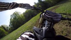 1080/60fps motocross bike hitting natural gap jump Stock Footage
