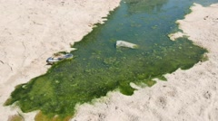 Pollution at the beach Stock Footage