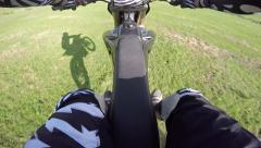 1080p/60fps dirt bike downhill jump in the meadows Stock Footage