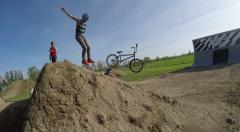 2.7k bmx riders bails out mid air great angle Stock Footage