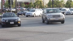 Cars making Left Turn at Streets Intersection Stock Footage