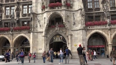 ULTRA HD 4K Tourist people take photo Marys Square Munich entrance town hall day Stock Footage