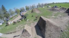 2.7k bird's eye view of bmx rider hitting jumps Stock Footage