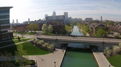 Stock Video Footage of Indianapolis City Canal with Downtown Skyline. 1080p.