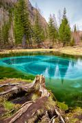 So-called blue geyser lake in Altay mountains - stock photo