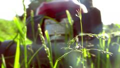 Man pushing a lawn mower, close up on grass in foreground - short cut - Full HD Stock Footage