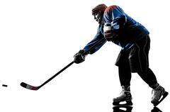 Ice hockey man player silhouette - stock photo