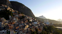 Aerial drone panning shot of hillside favela houses at sunrise Stock Footage
