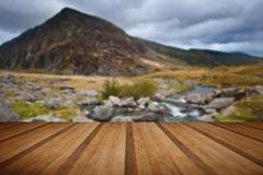 View over waterfall towards Pen-yr-Ole-Wen mountian in Snowdonia National Par - stock photo