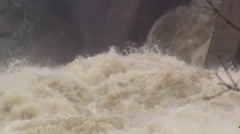 Water rushing fast and furious over hydroelectric power dam after storm. Stock Footage