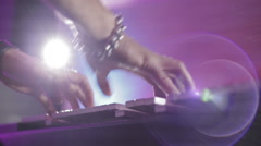 Hands playing on an electronic piano at the disco,shot with lens flare,low view Stock Footage