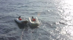 Two boats on the waves Stock Footage