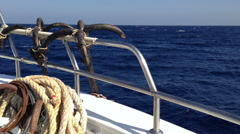 Blue sea boat sailing with open bow porthole in summer vacations Stock Footage