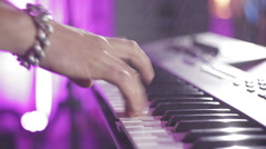 hands playing on an electronic piano at the disco,shot with lens flare - stock footage