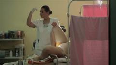 Pregnant woman lying on table for childbirth. Waiting for baby on maternity ward - stock footage