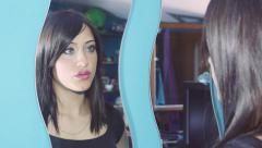 pensive woman looking herself in the mirror: hypnotized woman at the mirror - stock footage