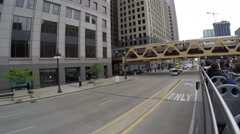 Metro train and the famous Chicago Theatre in downtown Chicago, Illinois, USA Stock Footage