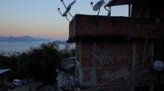 Favela Aerials: Rising Reveal of the Sugarloaf mountain at sunset Stock Footage
