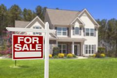 Home For Sale Real Estate Sign and Beautiful New House. Stock Photos