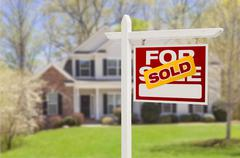 Sold Home For Sale Real Estate Sign in Front of Beautiful New House. Stock Photos
