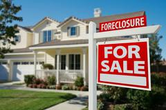 Foreclosure Home For Sale Real Estate Sign in Front of New House. - stock photo