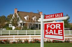 Short Sale Home For Sale Real Estate Sign in Front of New House. - stock photo