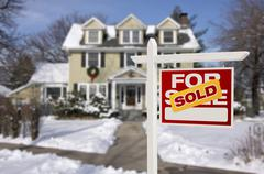 Sold Home For Sale Sign in Front of New House Stock Photos