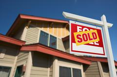 Sold Home For Sale Sign in Front of Beautiful New House. Stock Photos