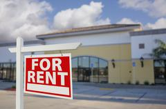 Vacant Retail Building with For Rent Real Estate Sign in Front. - stock photo