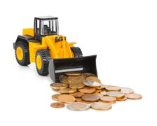 Stock Photo of Toy loader and money coins